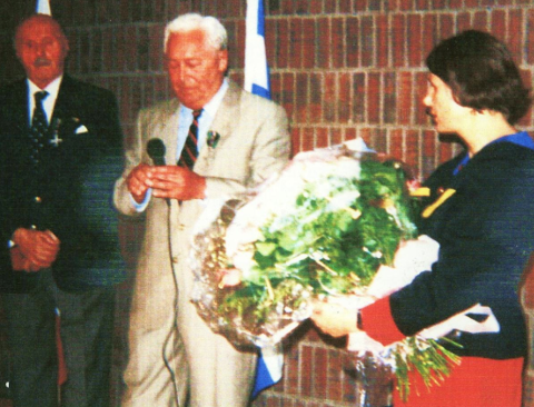 Ja-Jo delivering a speech at the Polish Consulate. Next to Ja-Jo is Edward Kemnitz to the right Consul General Małgorzata Dzieduszycka Montreal 1994